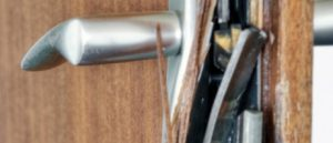 locksmith fixes your damaged door